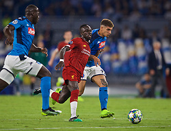NAPLES, ITALY - Tuesday, September 17, 2019: Liverpool's Sadio Mane (C) and SSC Napoli's Giovanni Di Lorenzo (R) during the UEFA Champions League Group E match between SSC Napoli and Liverpool FC at the Studio San Paolo. (Pic by David Rawcliffe/Propaganda)