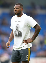 Leicester City's Wes Morgan in a t shirt in tribute to Vichai Srivaddhanaprabha