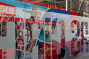 Bus shelter reflections from a construction site and for budget airline Ryanair on the side of a London bus, on 20th October 2017, in London, England.