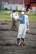 Members of an agricultural research team measure radiation levels in fields about 35 km from the leaking No.1 nuclear power plant in Iitate, Fukushima Prefecture, Japan on 31 Aug. 2011. Photograph: Robert Gilhooly