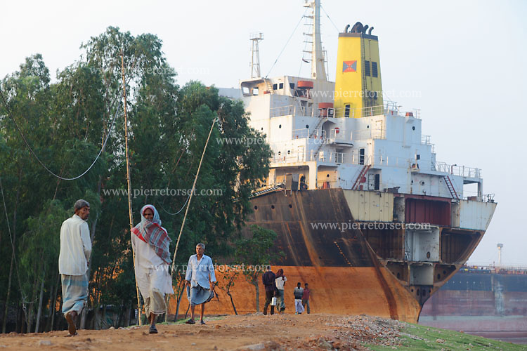 View of a ship being scrapped. It is the daily landscape for thousands of people working in this area. Most of them are involved in a job related to this industry.