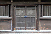 old wooden door entrance of a traditional Japanse garden house