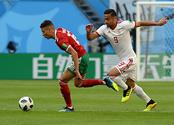 June 15, 2018 - Sochi, Rússia - SOCHI, SC - 15.06.2018: PORTUGAL VS SPAIN - Russia, St. Petersburg, on June 15, 2018. 2018 FIFA World Cup Russia. The match of the group stage of the FIFA World Cup - 2018 between national teams of Morocco and Iran. In the picture: (from left to right) player of Morocco national team Amin Arit and player of Iran national team Omid Ebrakhimi. (Credit Image: © Andrey Pronin/Fotoarena via ZUMA Press)
