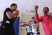 11 Nov. 2013 - Brooklyn, New York - Teresa Scott, the founder of Women's World of Boxing, teaches youth to box as part of a PowerPlay NYC event at the Ingersoll Community Center. Photo credit: Tanisia Morris/NYCity Photo Wire