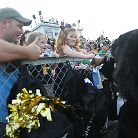 Duwaine Brown and his children Russell, 3, and Macyn, 6, say hi to the Amory panther mascot before the start of Friday night's game against Aberdeen.