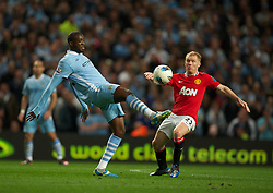 MANCHESTER, ENGLAND - Monday, April 30, 2012: Manchester City's Yaya Toure in action against Manchester United's Paul Scholes during the Premiership match at the City of Manchester Stadium. (Pic by David Rawcliffe/Propaganda)