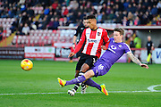 Ollie Watkins (14) of Exeter City is tackle by Glen Rea (16) of Luton Town during the EFL Sky Bet League 2 match between Exeter City and Luton Town at St James' Park, Exeter, England on 26 November 2016. Photo by Graham Hunt.
