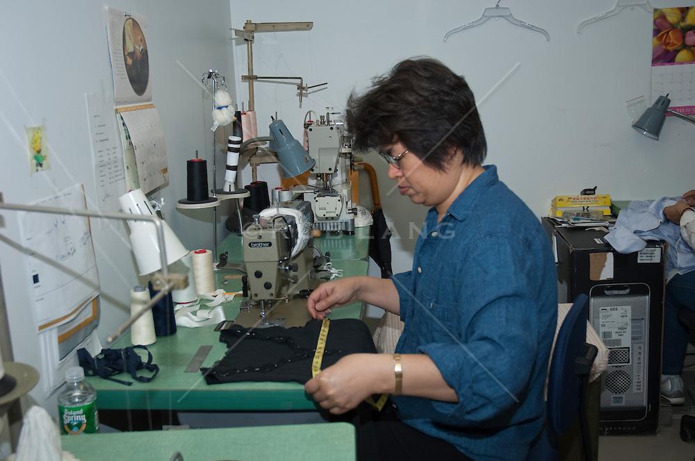 seamstress measuring a dress top
