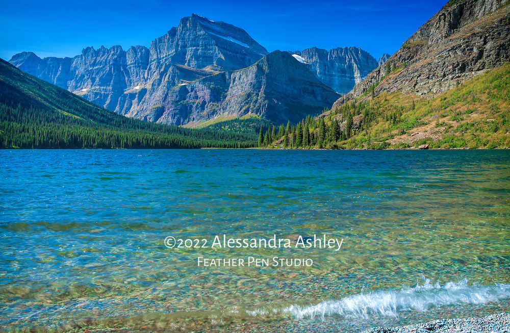 Glacier National Park's Two Medicine Lake, surrounded by wild mountain vistas.