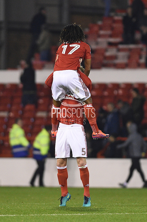 Nottingham Forest midfielder Hildeberto Pereira (17) and Nottingham Forest defender Matt Mills (5) celebrate a win during the EFL Sky Bet Championship match between Nottingham Forest and Birmingham City at the City Ground, Nottingham, England on 14 October 2016. Photo by Jon Hobley.