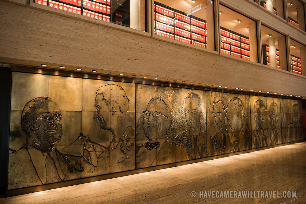 """A large mural, titled """"A Life in Politics"""", designed by Naomi Savage and engraved on magnesium, dating to 1971. The mural, on display in the museum of the LBJ Library, shows LBJ with the presidents he worked with in his political career. The LBJ Library and Museum (LBJ Presidnetial Library) is one of the 13 presidential libraries administered by the National Archives and Records Administration. It houses historical documents from Lyndon Johnson's presidency and political life as well as a museum."""