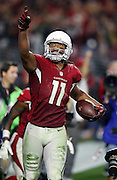 Arizona Cardinals wide receiver Larry Fitzgerald (11) points skyward as he runs with the ball after catching a pass for the winning touchdown during the NFL NFC Divisional round playoff football game against the Green Bay Packers on Saturday, Jan. 16, 2016 in Glendale, Ariz. The Cardinals won the game in overtime 26-20. (©Paul Anthony Spinelli)