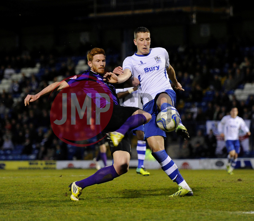 Bury's Jim McNulty clears the ball away from danger under pressure from Bristol Rovers' Matt Harrold - Photo mandatory by-line: Dougie Allward/JMP - Mobile: 07966 386802 01/04/2014 - SPORT - FOOTBALL - Bury - Gigg Lane - Bury v Bristol Rovers - Sky Bet League Two