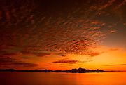 MEXICO, BAJA CALIFORNIA SOUTH Sea of Cortez near Loreto with the Isle del Carmen and the Isle Monserrat beyond at sunrise