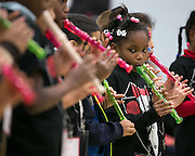 """Symia Wyatt plays the recorder with her """"ROCmusic Readiness"""" group at the ROC The Night Away holiday concert at the David F. Gantt Community Center in Rochester on Wednesday, December 17, 2014."""