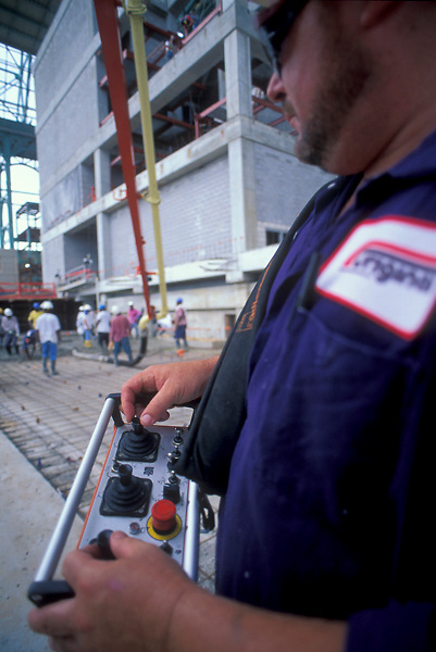 Stock photo of a man operating controls for heavy construction machinery