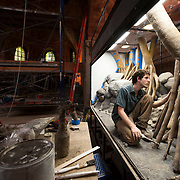 July 2, 2013 - New York, NY: <br /> Wildlife Conservation Society Exhibit Specialist Nikolai Jacobs works on an enclosure for a Mertens' water monitor lizard at the Bronx Zoo on Tuesday afternoon. The enclosure, which is designed to evoke the water monitor's native Australian habitat, will be part of a new exhibit in zoo center, which will house monitor lizards including Komodo Dragons. <br /> CREDIT: Karsten Moran for The New York Times
