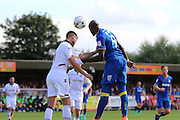 AFC Wimbledon striker Tom Elliott (9) and Bolton Wanderers striker Gary Madine (14) during the EFL Sky Bet League 1 match between AFC Wimbledon and Bolton Wanderers at the Cherry Red Records Stadium, Kingston, England on 13 August 2016. Photo by Stuart Butcher.