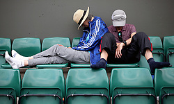 Spectators relax on day three of the Wimbledon Championships at the All England Lawn Tennis and Croquet Club, Wimbledon.