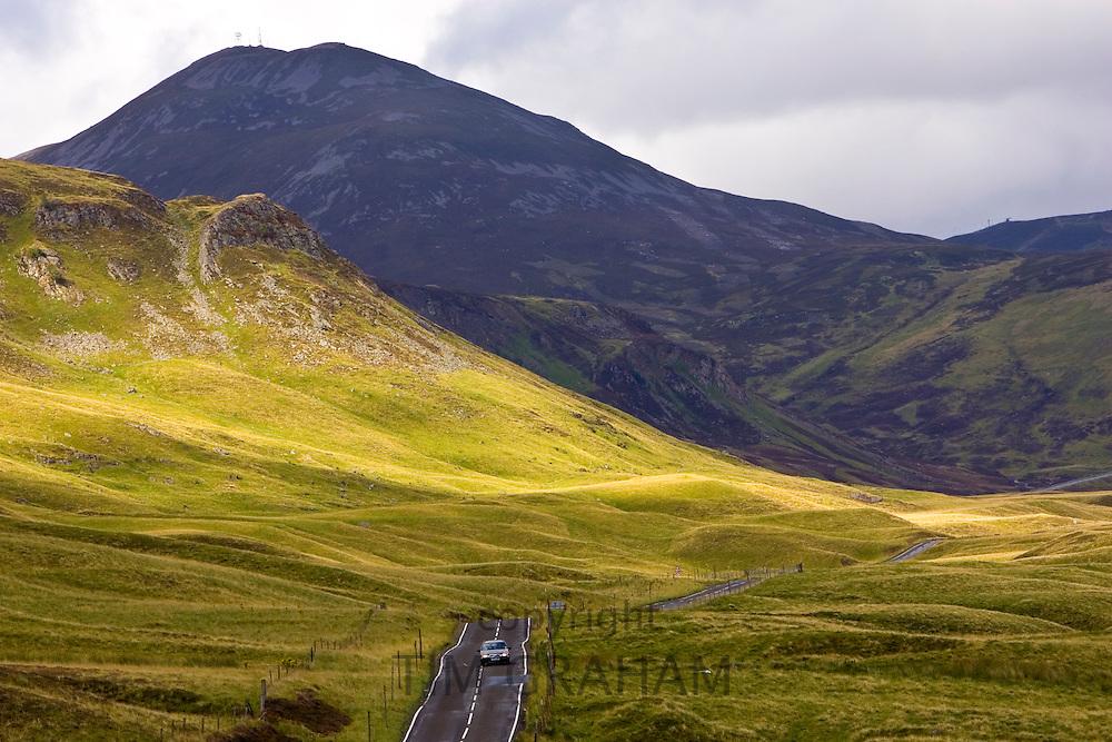 Car drives through the Glen Clunie hills and Grampian Mountains, Scotland, United Kingdom