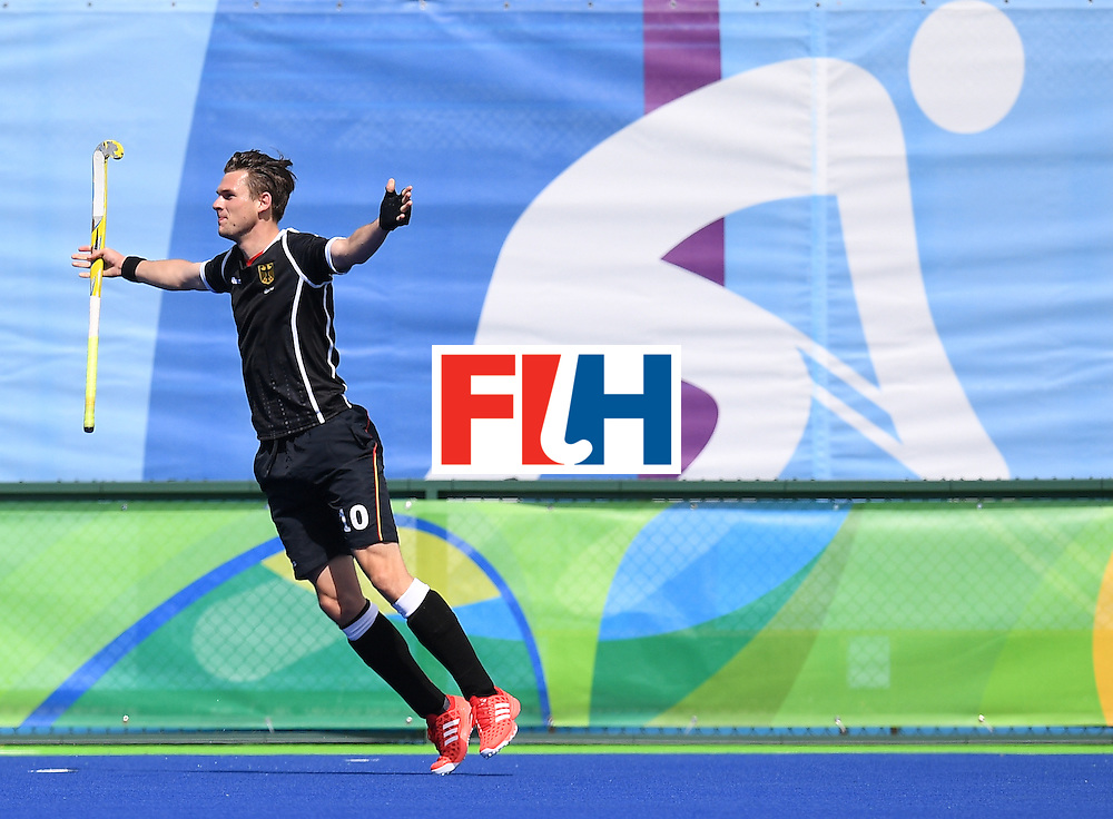 Germany's Christopher Wesley celebrates scoring a goal during the men's field hockey Argentina vs Germany match of the Rio 2016 Olympics Games at the Olympic Hockey Centre in Rio de Janeiro on August, 11 2016. / AFP / MANAN VATSYAYANA        (Photo credit should read MANAN VATSYAYANA/AFP/Getty Images)