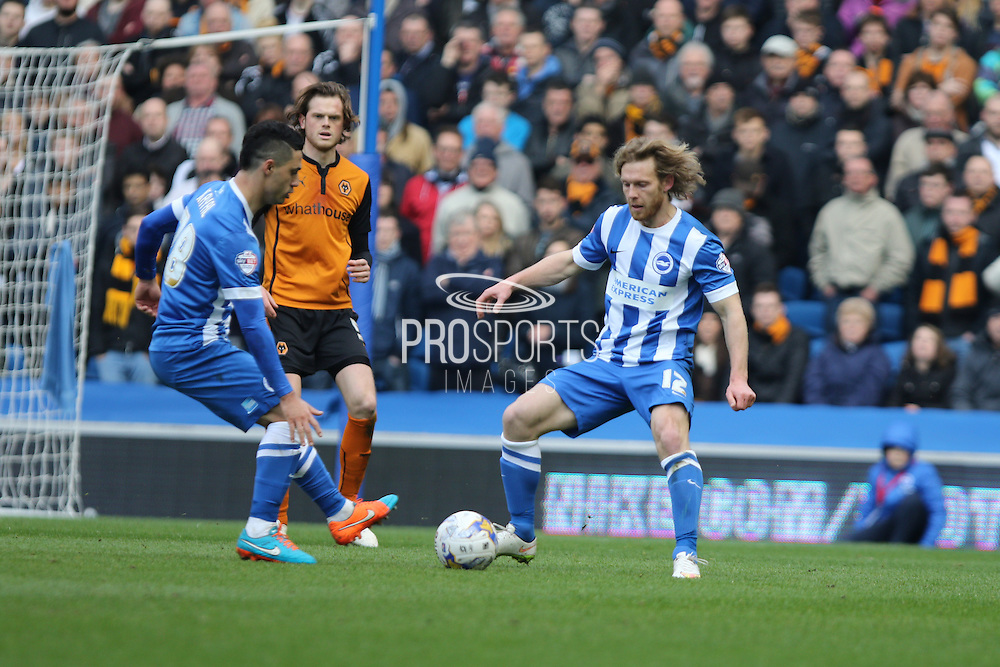 Brighton's Craig Mackail-Smith and Beram Kayal watched by Wolves Richard Stearman during the Sky Bet Championship match between Brighton and Hove Albion and Wolverhampton Wanderers at the American Express Community Stadium, Brighton and Hove, England on 14 March 2015. Photo by Geoff Penn.