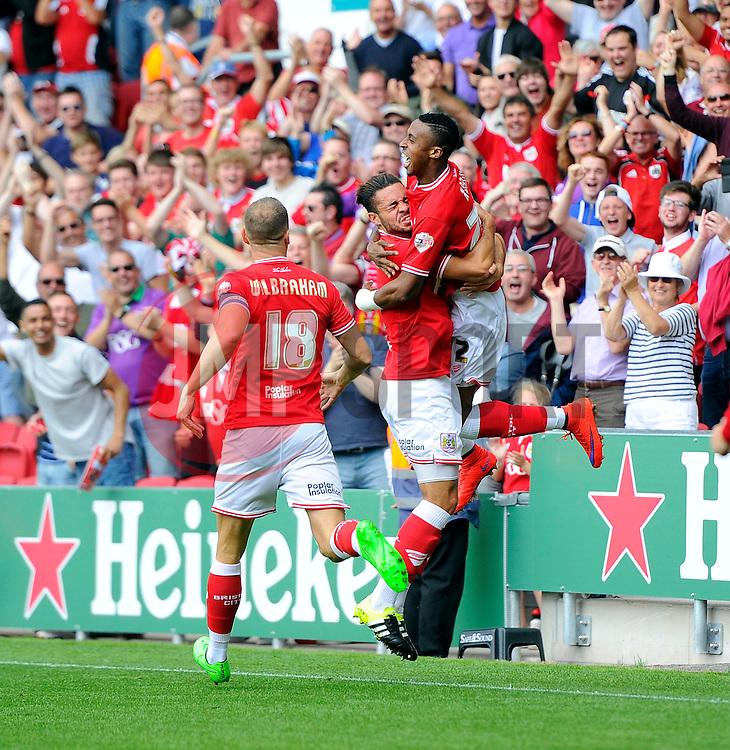 Jonathan Kodjia of Bristol City celebrates with Derrick Williams of Bristol City  - Mandatory byline: Joe Meredith/JMP - 07966386802 - 15/08/2015 - FOOTBALL - Ashton Gate -Bristol,England - Bristol City v Brentford - Sky Bet Championship