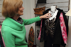 Volunteer arranging a display at a Mysight charity shop.