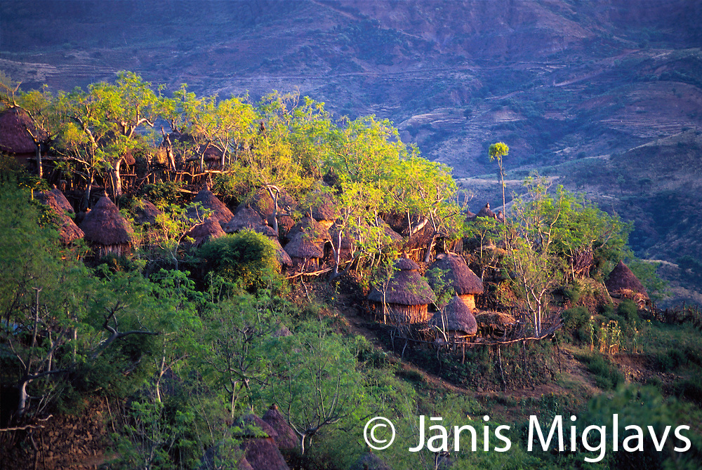 Sunset light hits the traditional Konso tribe village of Busso at the edge of the Omo region in Ethiopia, Africa.