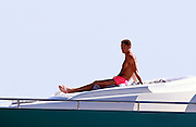 IBIZA, SPAIN, 2016, JULY 16 <br /> <br /> After winning his first European Championship, Cristiano Ronaldo  enjoy a well deserved vacation in the paradisiacal beaches of Ibiza, one of his favorite destinations. The Portuguese striker landed on Tuesday at noon on the island accompanied by his son cristiano, his mother, Dolores Aveiro and a large group of friends. The whole group enjoyed a fun day at sea where the Real Madrid star showed his most endearing facet. The consecrated footballer took the opportunity to take a refreshing dip.  Wearing a green apple bathing suit, showed off his muscled torso while delighting everyone present with his risky pirouettes to jump into the sea. His son looked excited the spectacle offered by her proud dad<br /> ©Exclusivepix Media