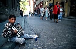 POLAND WARSAW AUG96 - A gypy boy plays the accordeon in Warsaw's rebuilt Old Town.<br /> <br /> jre/Photo by Jiri Rezac<br /> <br /> &copy; Jiri Rezac 1996<br /> <br /> Tel:   +44 (0) 7050 110 417<br /> Email: info@jirirezac.com<br /> Web:   www.jirirezac.com