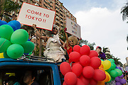 Drag queens hold signs at Taipei's Pride festival. A large group from Japan were on hand to promote Tokyo's 2015 LGBT Pride event.