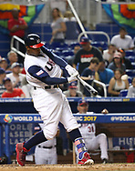 March 12, 2017 - Miami, FL, USA - United States center fielder Adam Jones hits a double during the eighth inning of a World Baseball Classic first round Pool C game against Canada on Sunday, March 12, 2017 at Marlins Park in Miami, Fla. (Credit Image: © David Santiago/TNS via ZUMA Wire)