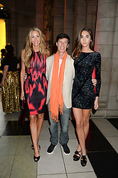 Left to right, LISA BUTCHER, MICHAEL JACOBSON and her daughter AMBER DONOSO at the opening of Club To Catwalk: London Fashion In The 1980's an exhibition at The V&A Museum, London on 8th July 2013.