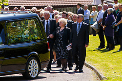 © Licensed to London News Pictures. 12/06/2015. Fort William, UK. The funeral of ex-Liberal Democrat leader Charles Kennedy takes place at St John's Church in Caol, near his Fort William home in Scotland on Friday, June 12, 2015. Mr Kennedy died suddenly on June 1, 2015 at the age of 55 after suffering a major haemorrhage as a result of a long battle with alcoholism. Photo credit: Tolga Akmen/LNP