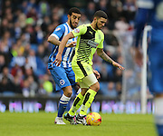 Huddersfield Town striker Nahki Wells (21) ans Brighton winger, Elvis Manu (19) during the Sky Bet Championship match between Brighton and Hove Albion and Huddersfield Town at the American Express Community Stadium, Brighton and Hove, England on 23 January 2016.