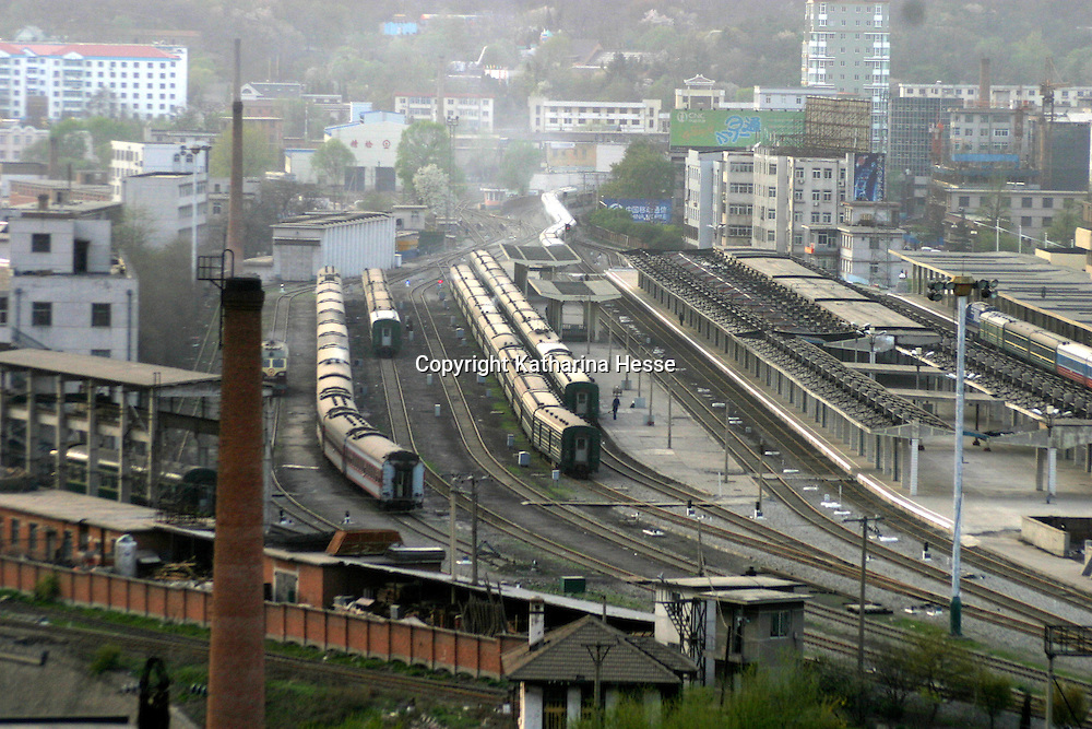 DANDONG, CHINA - APRIL 24: Chinese trains are seen at Dandong railway station which borders the North Korean town of Sinuiju on April 24, 2004 in Dandong, China. On April 22, 2004 at least 154 people died and more than 1300 were injured following a train explosion in Ryonchon, a North Korean town 20 km from the Dandong border. China has vowed to give North Korea $1.21 million worth of medical supplies, tents and food to help it cope with the disaster