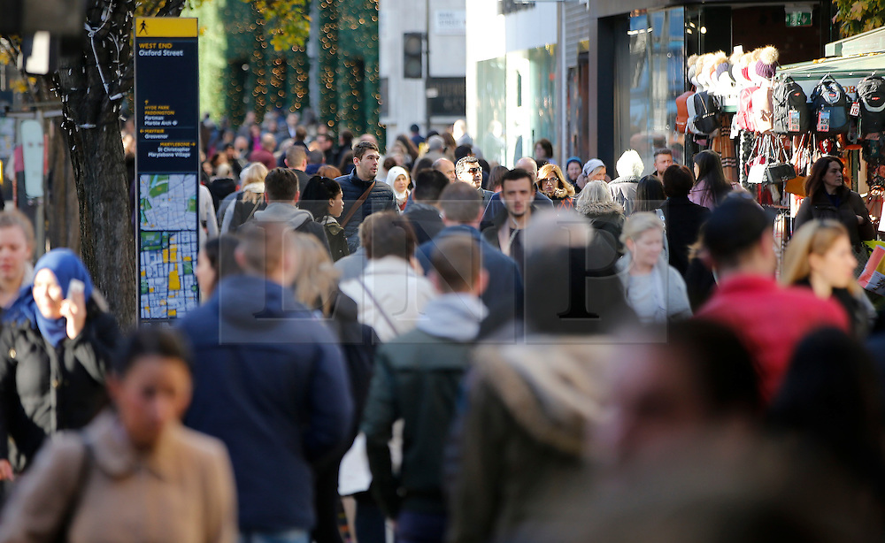"""© Licensed to London News Pictures. 25/11/2016. London, UK. Shoppers head out early to grab bargains on Oxford Street, central London on """"Black Friday"""". Sales from this years Black Friday event are expected to top £2 billion. Photo credit: Tolga Akmen/LNP"""