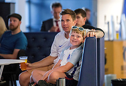 Fans sit in the fanzone in the South Stand concourse to watch England vs Slovakia - Mandatory by-line: Robbie Stephenson/JMP - 20/06/2016 - FOOTBALL - Ashton Gate - Bristol, United Kingdom  - England vs Slovakia - UEFA Euro 2016