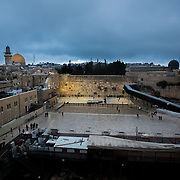 A general view of The Western Wall, Dome of the Rock,  and surrounding area are seen as snow and rain fall in The Old City on January 7, 2015 in Jerusalem, Israel. (Photo by Elan Kawesch)
