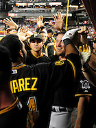 Sep. 20 2011; Phoenix, AZ, USA; Pittsburgh Pirates infielder Pedro Alvarez (24) is congratulated by teammates after hitting a solo home run  during the second inning against the Arizona Diamondbacks at Chase Field.  Mandatory Credit: Jennifer Stewart-US PRESSWIRE..