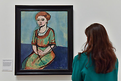"© Licensed to London News Pictures. 01/08/2017. London, UK. A visitor views ""Portrait of Olga Merson"", 1911.  Preview of ""Matisse in the Studio"", at the Royal Academy of Arts, Piccadilly, the first exhibition to consider how the personal collection of treasured objects of Henri Matisse were both subject matter and inspiration for his work.  Around 35 objects are displayed alongside 65 of Matisse's paintings, sculptures, drawings, prints and cut-outs.  The exhibition runs 5 August to 12 November 2017.  Photo credit : Stephen Chung/LNP"