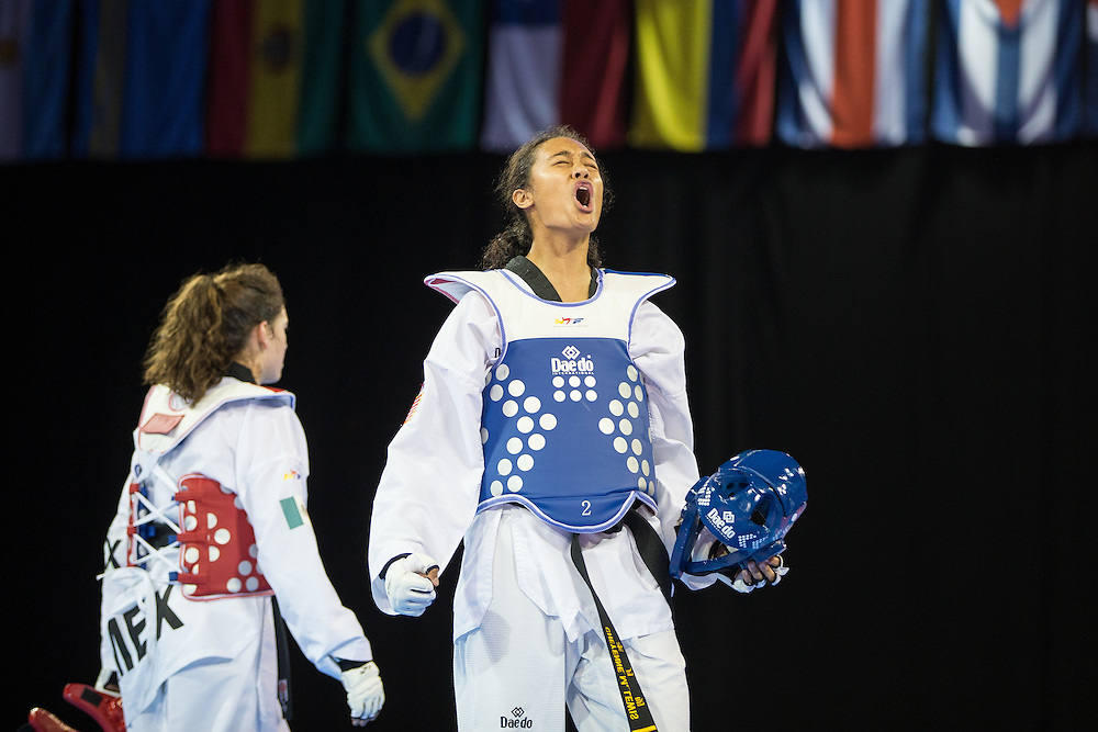 Cheyenne Lewis of the United States celebrates her gold medal win over Paulina Armeria of Mexico in the women's -57kg weight division of Taekwondo at the 2015 Pan American Games in Toronto, Canada, July 20,  2015.  AFP PHOTO/GEOFF ROBINS