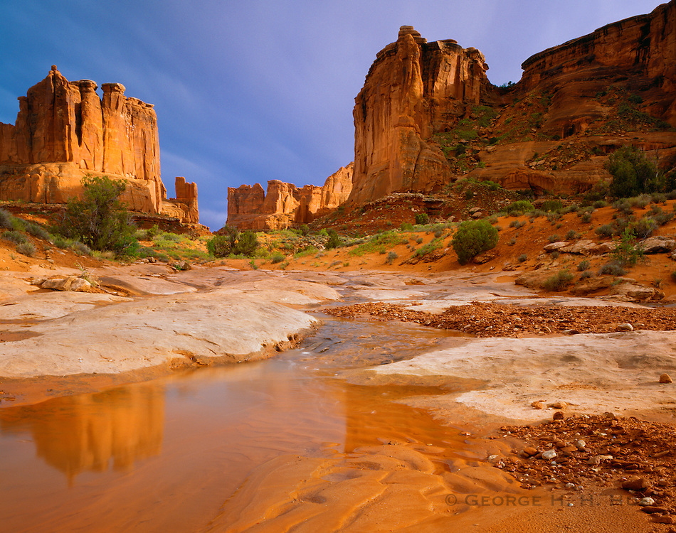 0301-1042 ~ Copyright:  George H. H. Huey ~ 'Park Avenue' with the Courthouse Towers and flooded wash.  Arches National Park, Utah.