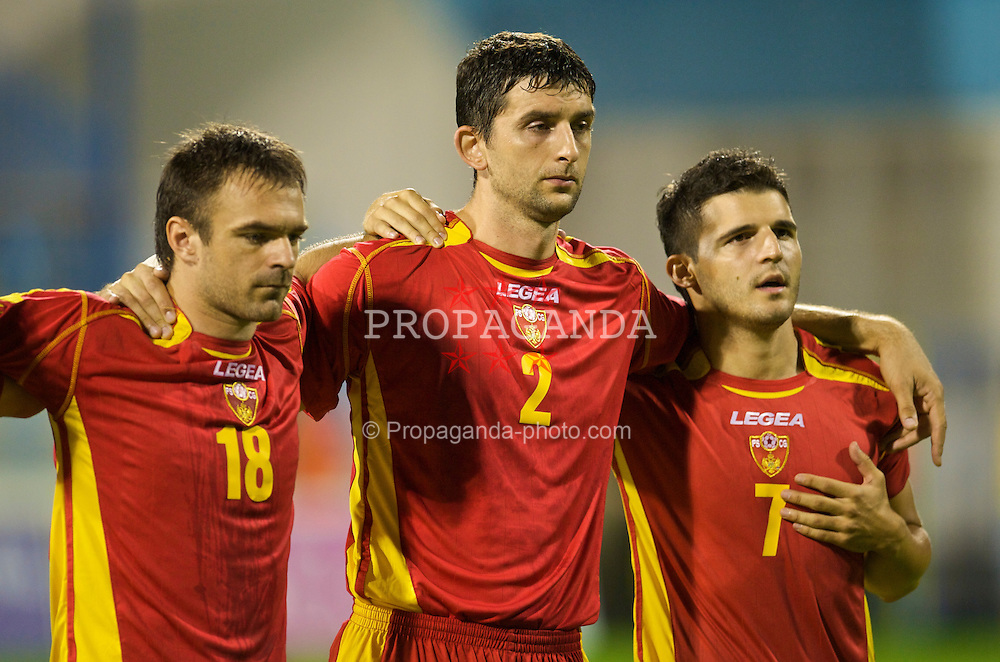 PODGORICA, MONTENEGRO - Wednesday, August 12, 2009: Montenegro's Nikola Drincic, Miodrag Dzudovic and Simon Vukcevic before an international friendly match against Wales at the Gradski Stadion. (Photo by David Rawcliffe/Propaganda)