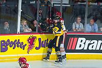 REGINA, SK - MAY 22:  Nicholas Caamano #10 of Hamilton Bulldogs checks a player of Acadie-Bathurst Titan at Brandt Centre - Evraz Place on May 22, 2018 in Regina, Canada. (Photo by Marissa Baecker/Getty Images)