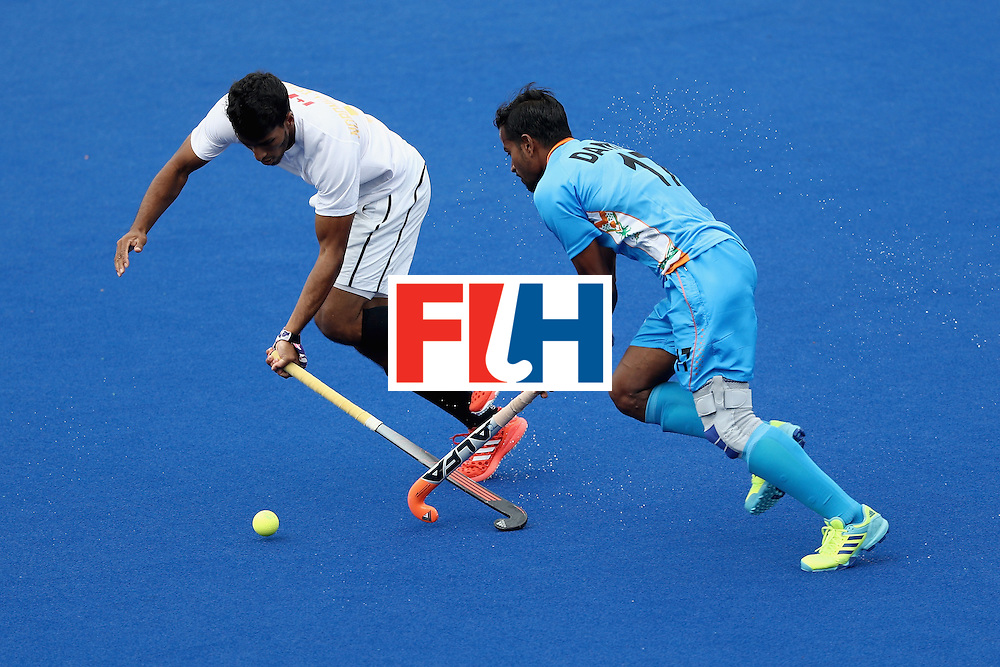 RIO DE JANEIRO, BRAZIL - AUGUST 12:  Danish Mujtaba #17 of India chases Devohn Noronha Teixeira #5 of Canada during a Men's Preliminary Pool B match on Day 7 of the Rio 2016 Olympic Games at the Olympic Hockey Centre on August 12, 2016 in Rio de Janeiro, Brazil.  (Photo by Sean M. Haffey/Getty Images)