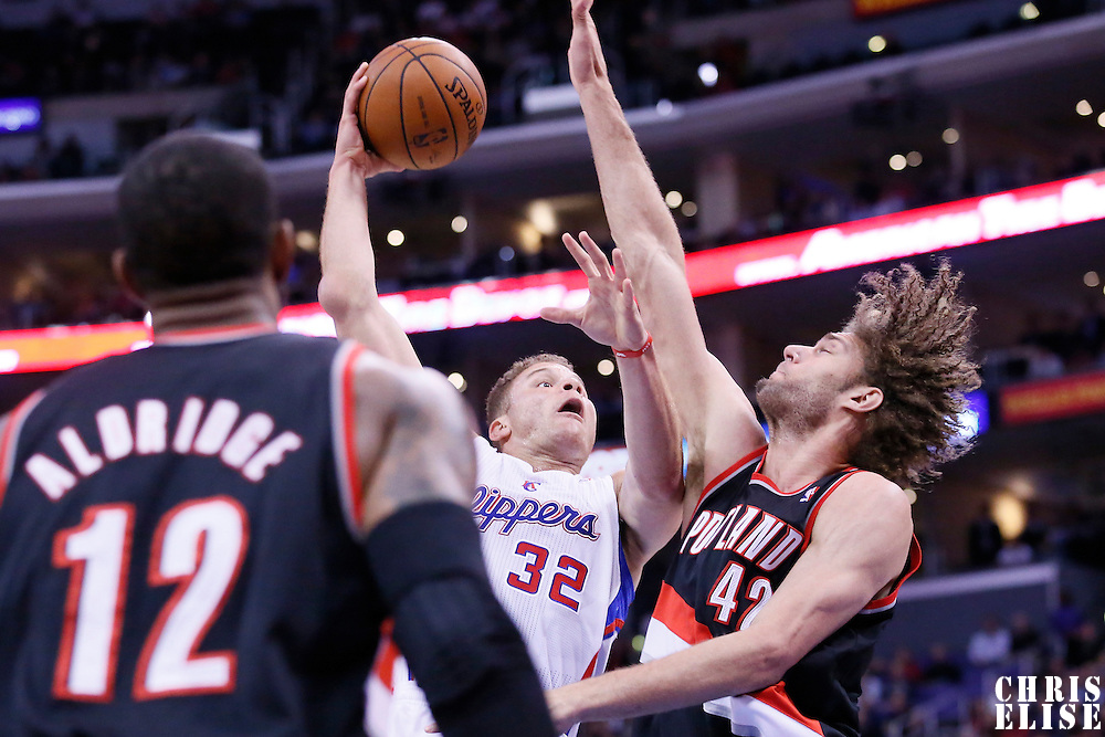 12 February 2014: Los Angeles Clippers power forward Blake Griffin (32) goes for the skyhook over Portland Trail Blazers center Robin Lopez (42) during the Los Angeles Clippers 122-117 victory over the Portland Trail Blazers at the Staples Center, Los Angeles, California, USA.