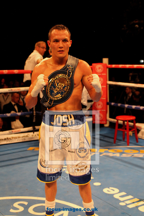 Josh Warrington  (White/Blue Shorts ) and Davide Dieli (Silver/Green Shortts ) during their Vacant European Featherweight title bout at the First Direct Arena, Leeds<br /> Picture by Stephen Gaunt/Focus Images Ltd +447904 833202<br /> 04/10/2014