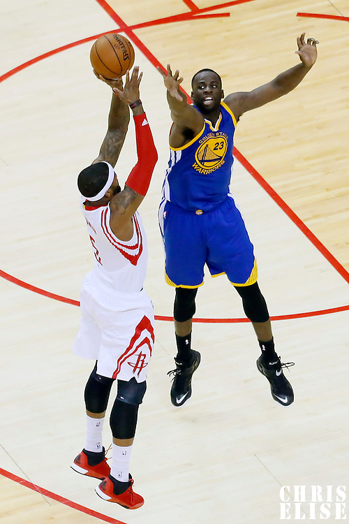 23 May 2015: Houston Rockets forward Josh Smith (5) takes a jump shot over Golden State Warriors forward Draymond Green (23) during the Golden State Warriors 115-80 victory over the Houston Rockets, in game 3 of the Western Conference finals, at the Toyota Center, Houston, Texas, USA.